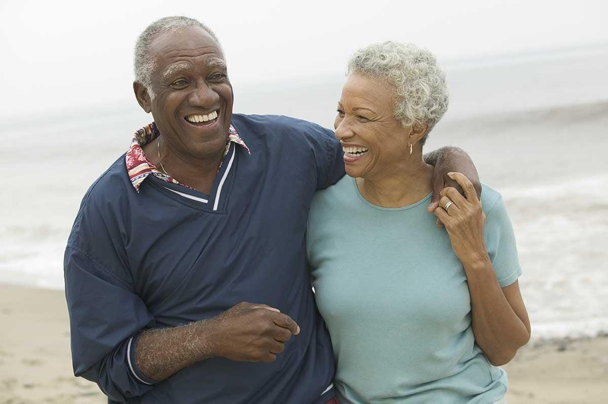 cheerful couple at beach